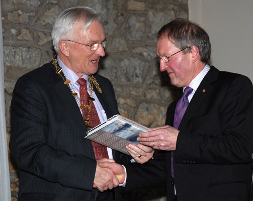 John Hooton presenting IPF president John Cuddihy with a copy of his book